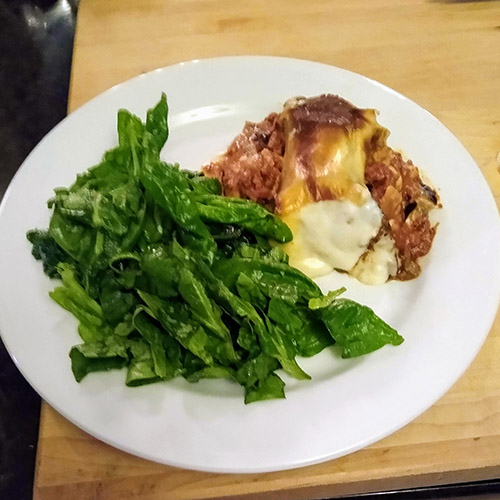 Moussaka plated with salad