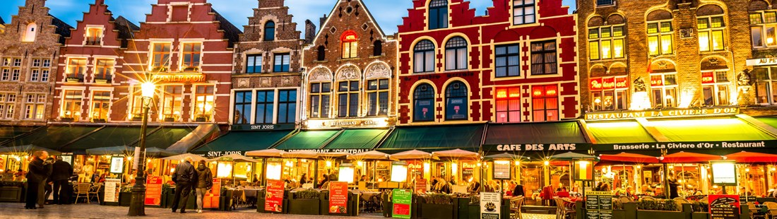 belgium-bruges-market-square-illuminated-at-dusk.jpg