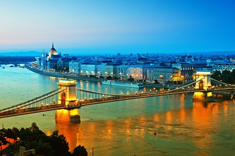 Danube River bridge and Parliament Building at dusk, Budapest, Hungary