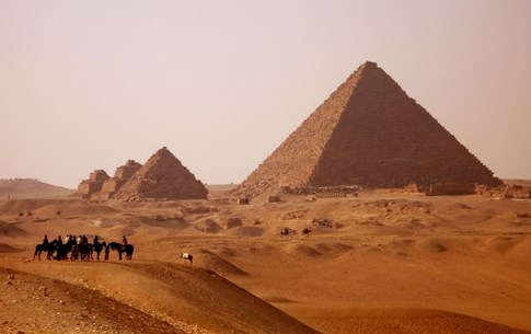 People on horses in front of Giza Pyramids, Egypt
