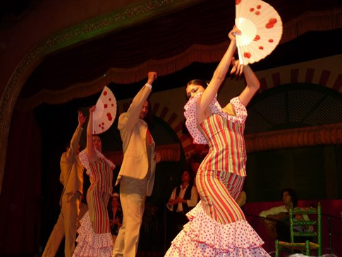Flamenco dancers with stripes and dots on dresses, Spain