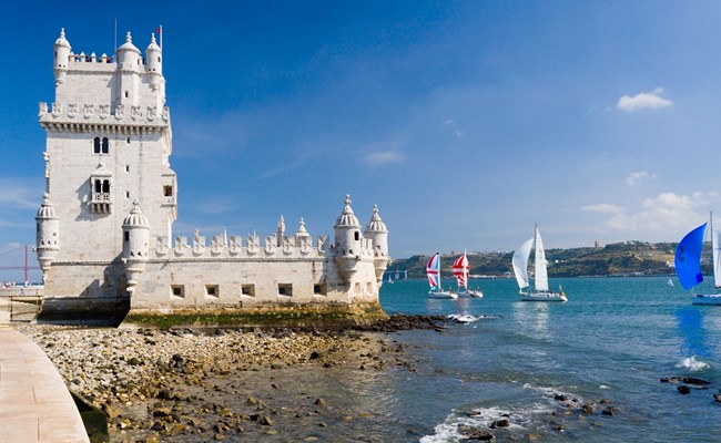 portugal-lisbon-tower-of-belem-with-boats-on-water.jpg