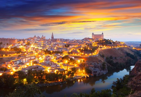 Aerial view of Toledo at night with bright lights, Spain
