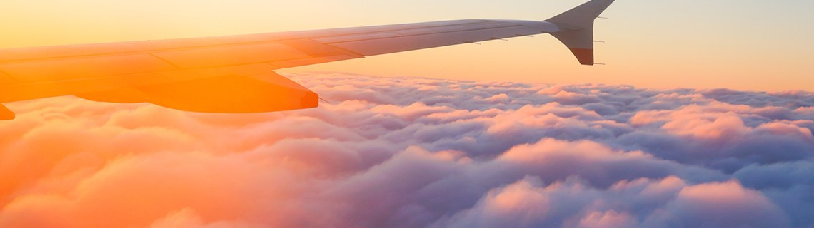 airplane-wing-above-clouds.jpg