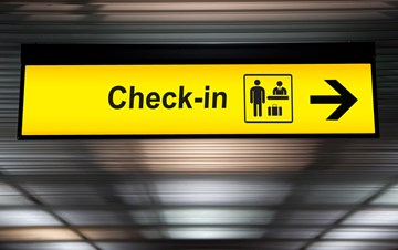 airport-check-in-sign-with-arrow-yellow.jpg