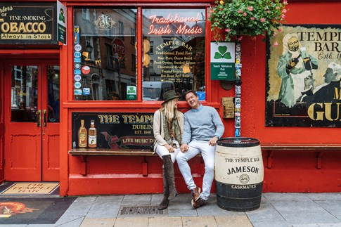 Couple sitting outside Temple Bar in Dublin, Ireland