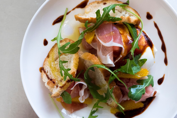 prosciutto with bread, olive oil, balsamic, and arugula