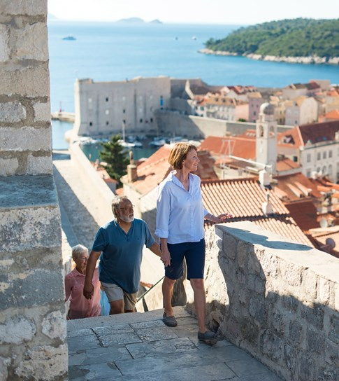 Tourists walking up stairs in Dubrovnik, Croatia